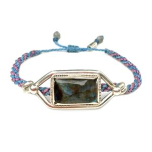 Labradorite silver bracelet with hand-knotted violet and blue rope by designer Coco Paniora Salinas of RUMI SUMAQ jewelry. Handmade on Martha's Vineyard.
