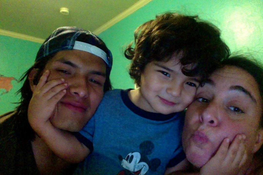 Co-owners of Rumi Sumaq Melanie Vento and Coco Paniora Salinas with their son