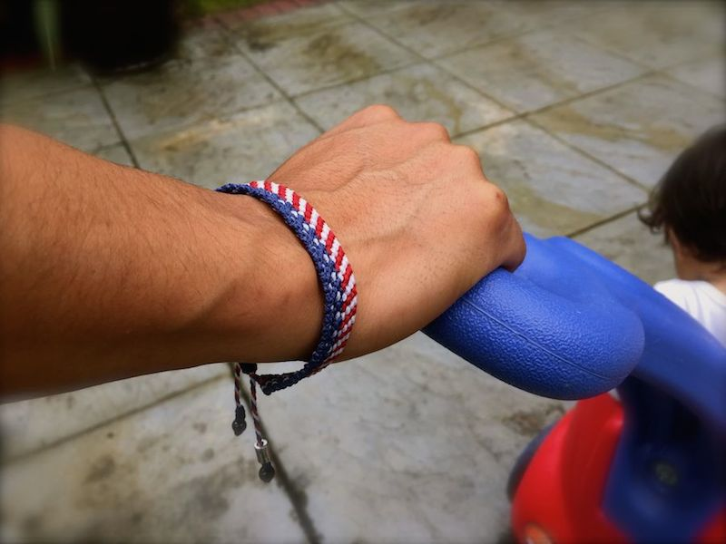 American Flag Bracelet by Coco Paniora Salinas of Rumi Sumaq. Come see his work at the Memorial Day Weekend Vineyard Artisans Festival. #marthasvineyard