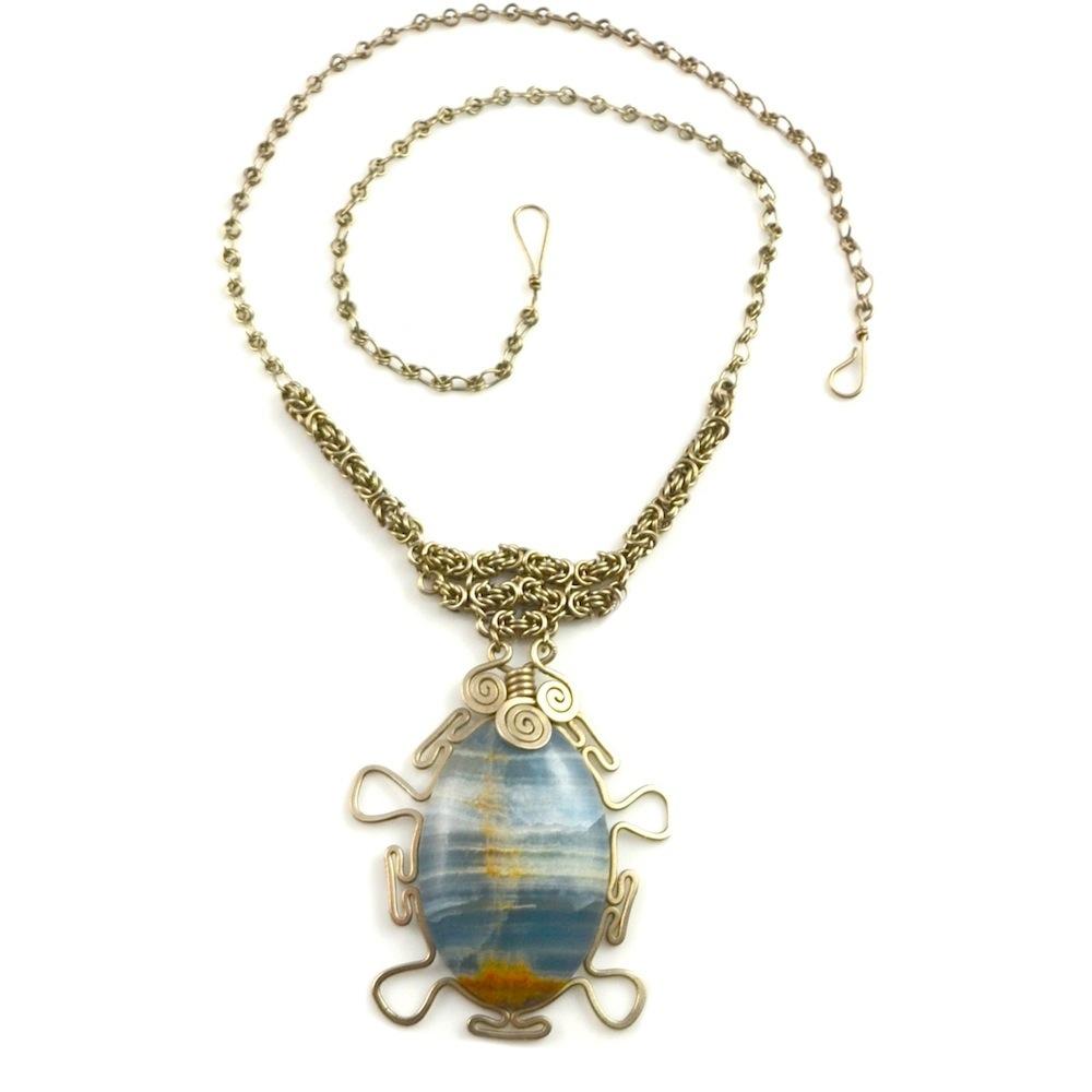 Art jewelry wirework Urqu Necklace by designer Coco Paniora Salinas of Rumi Sumaq rumisumaq.com