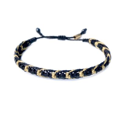 Black macrame bracelet with Metallic Gold Cord by Designer Coco Paniora Salinas of Rumi Sumaq. Handmade bohemian beach jewelry made on the beautiful island of Martha's Vineyard.
