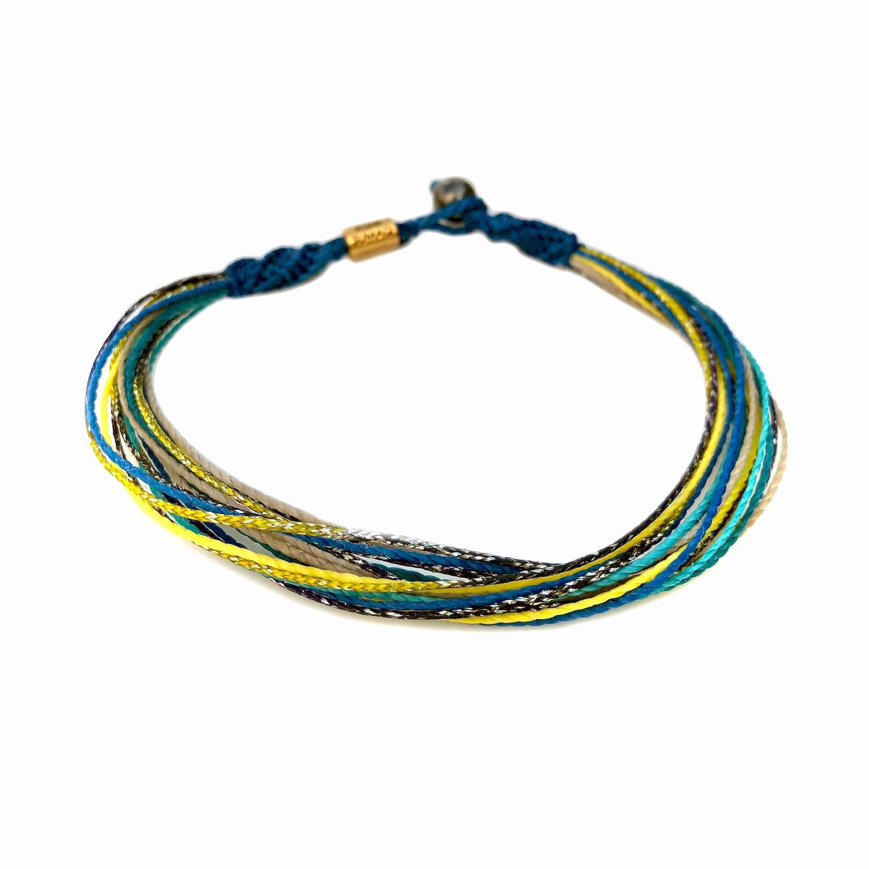 Boho ankle bracelet in blue yellow and metallic purple waxed cord | Rumi Sumaq handmade beach jewelry from Martha's Vineyard