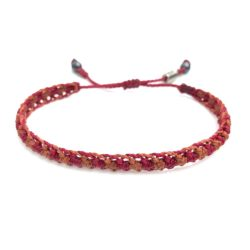 Braided bracelet maroon rust orange. RUMI SUMAQ surfer bracelets handwoven on Martha's Vineyard by designer Coco Paniora Salinas.