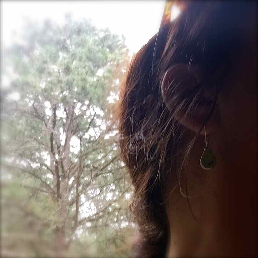 Green Serpentine earrings by designer Coco Paniora Salinas of Rumi Sumaq. Handmade Sterling Silver healing stone jewelry.