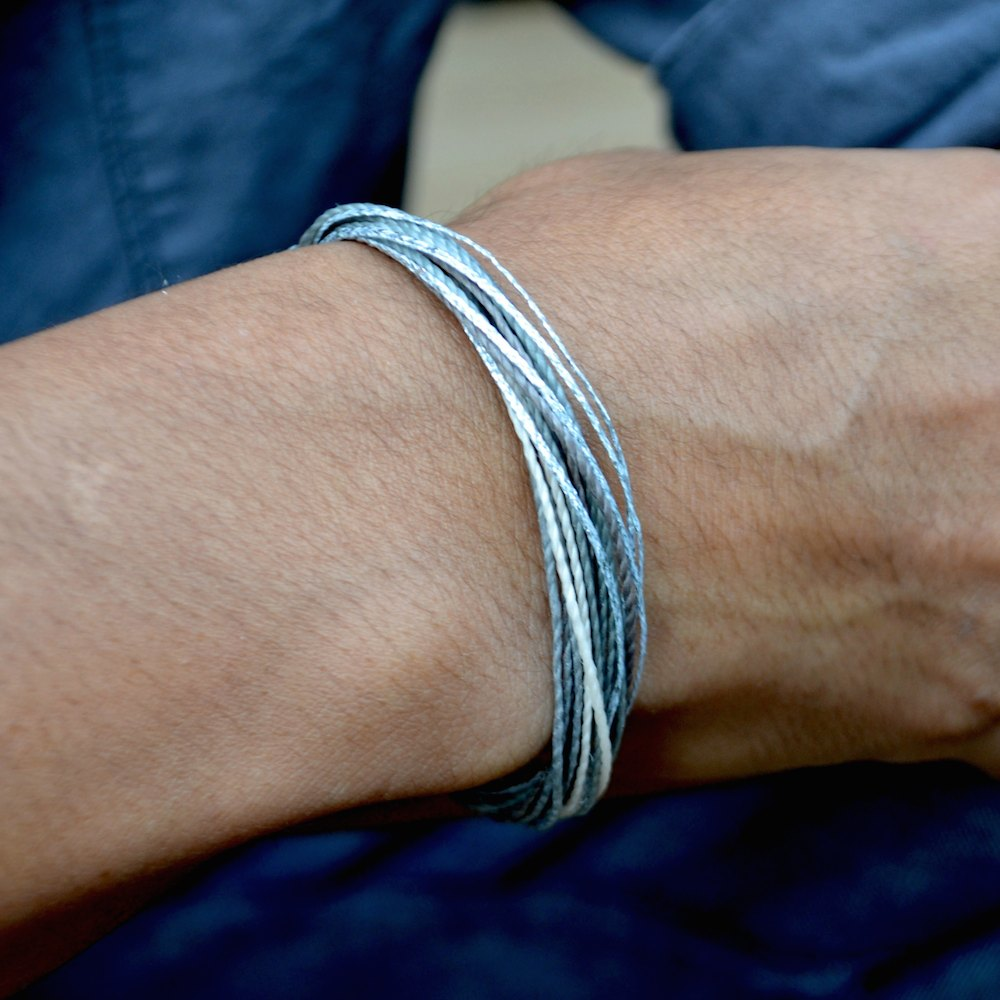String Surfer Bracelet Grey: Hand-Knotted Sailor and Surfer Bracelets by Rumi Sumaq. Handmade on Martha's Vineyard.