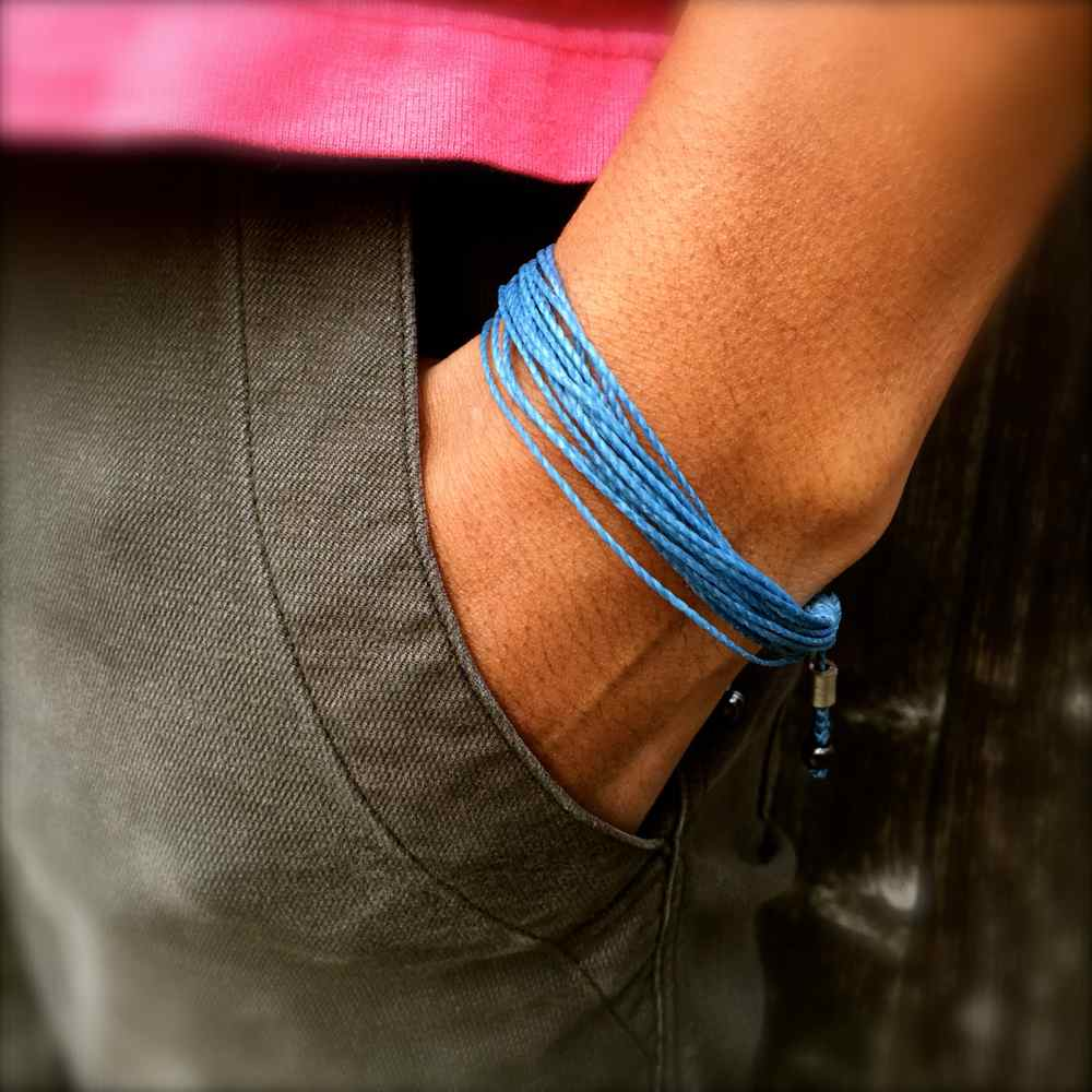 Light Blue Awareness Bracelet: Handmade String Bracelets by Rumi Sumaq