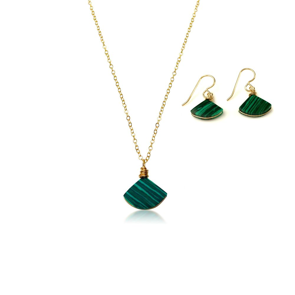 Malachite jewelry set gold by RUMI SUMAQ. The set includes beautiful Malachite stones cut in a triangular shape and expertly set in gold filled wire. The chain is dainty and delicate making it a lovely gift set form someone who loves minimalist jewelry.