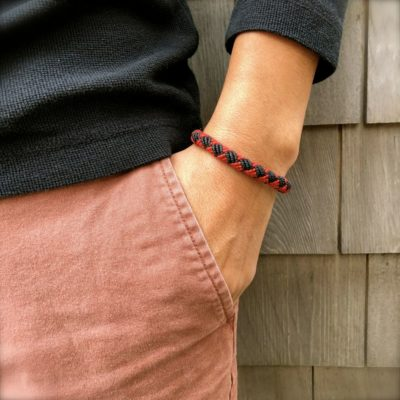 Mens rope bracelet black and red by designer Coco Paniora Salinas of RUMI SUMAQ. Hand-knotted in his art jewelry studio on Martha's Vineyard.