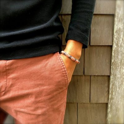 Mens rope bracelet in navy and coral orange by designer Coco Paniora Salinas of RUMI SUMAQ jewelry. Handmade on Martha's Vineyard.
