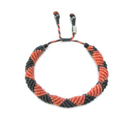 Mens rope bracelet in navy and coral orange by designer Coco Paniora Salinas of RUMI SUMAQ jewelry. Handmade on Martha's Vineyard.