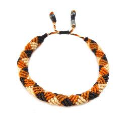 Mens rope bracelet orange and brown by designer Coco Paniora Salinas of RUMI SUMAQ. Handmade art jewelry from Martha's Vineyard.