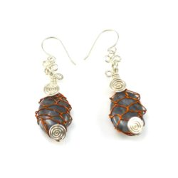 Silver and copper wirework Lupu earrings by Coco Paniora Salinas of Rumi Sumaq