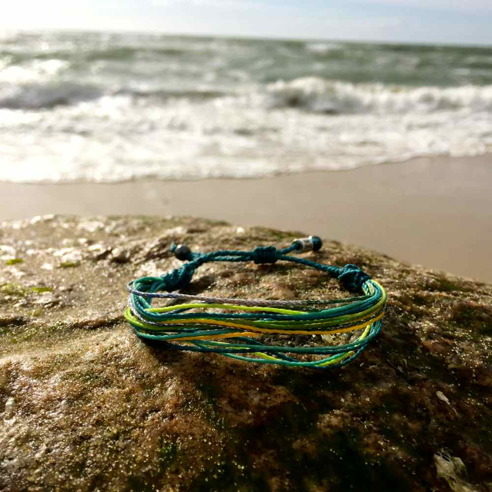 String Surfer Bracelet Aqua Yellow Lime Green Turquoise and Metallic Purple: Handmade on Martha's Vineyard Waxed Cord Sailor and Surf Bracelets by Rumi Sumaq