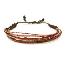 String surfer bracelet brown coral pink yellow by RUMI SUMAQ jewelry. Handmade on Martha's Vineyard by art jewelry designer Coco Paniora Salinas.