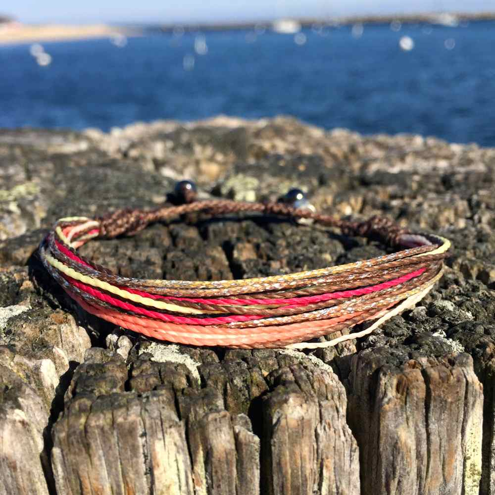 String Surfer Bracelet Brown Coral Hot Pink Off White and Metallic Yellow: Handmade on Martha's Vineyard Waxed Cord Sailor and Surf Bracelets by Rumi Sumaq