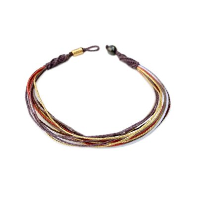 Summer anklet in muted purple, orange, metallic gold, brown and white | Rumi Sumaq summer beach jewelry handmade on Marthas Vineyard by designer Coco Paniora Salinas