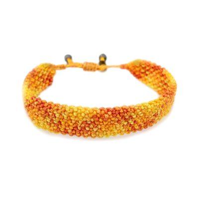 Yellow macrame bracelet by designer Coco Pandora Salinas of Rumi Sumaq. Handmade jewelry studio on Martha's Vineyard.